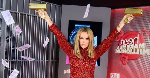 Amanda Holden shows off incredible legs in tiny red dress as she gives away £1m
