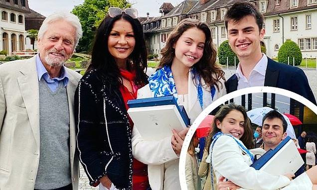 Catherine and Michael pose with Carys, 18, at high school graduation