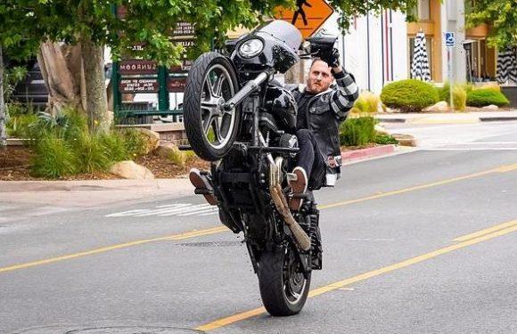 Chet Hanks pops wheelies in Malibu on his Harley-Davidson motorcycle