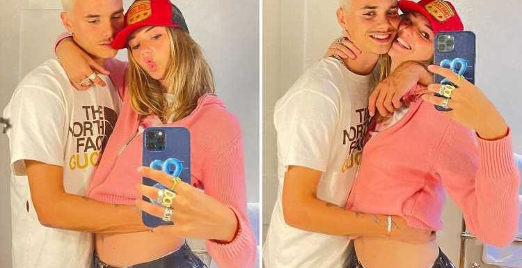 David and Victoria Beckham's son Romeo, 18, sparks rumours his model girlfriend Mia Regan is PREGNANT with loved up snap