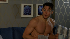 EastEnders viewers swoon as Sharon's brother Zack strips down for shower and shows off abs of steel