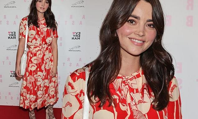 Jenna Coleman cuts a stylish figure in a red floral dress