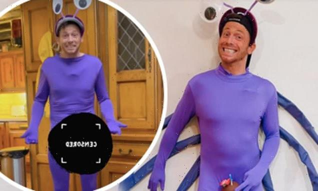 Joe Swash forced to protect his modesty in VERY tight purple costume