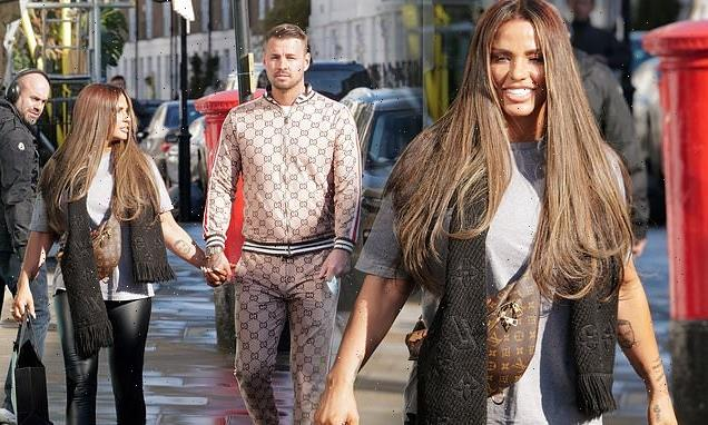 Katie Price and fiancé Carl Woods hold hands on London stroll