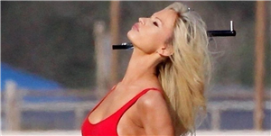 Lily James Looks Exactly Like Pamela Anderson in Her Iconic Red 'Baywatch' Swimsuit