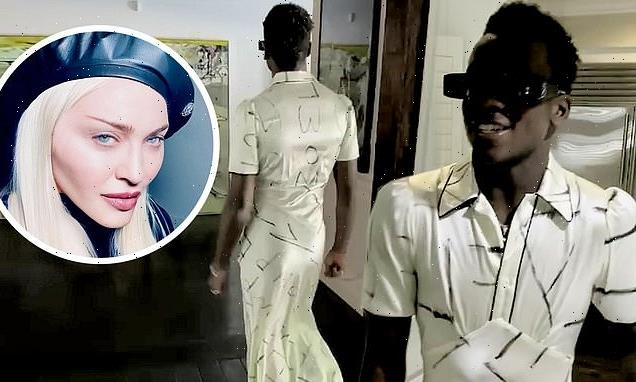 Madonna's son David, 15, looks glamorous as he struts in a dress