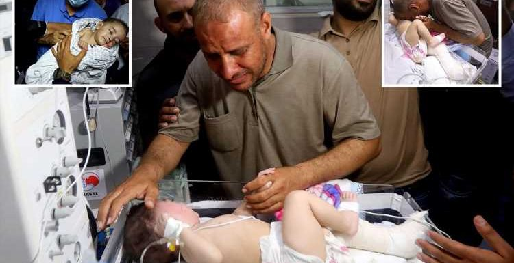Moment dad reunited with baby boy who was pulled from rubble of Israeli air strike that killed mum and 4 brothers