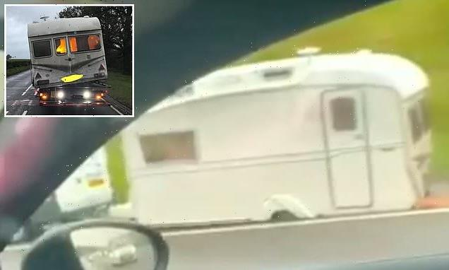 Sparks fly from underneath caravan as driver hauls it along motorway