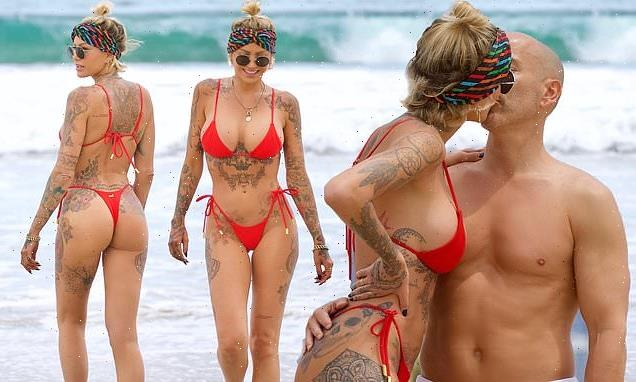 Tina Louise is red hot in thong bikini as she kisses Brett Oppenheim