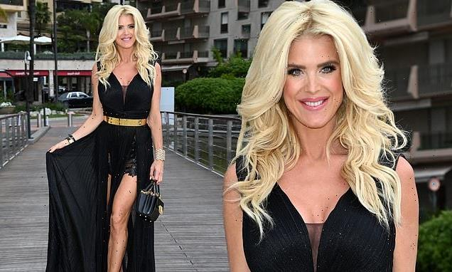 Victoria Silvstedt, 46, flashes her lithe legs in a floaty black gown