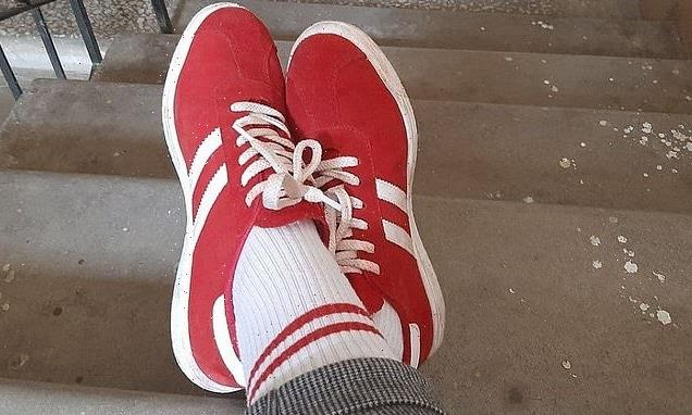 Woman is fined £650 for wearing red and white socks in Belarus