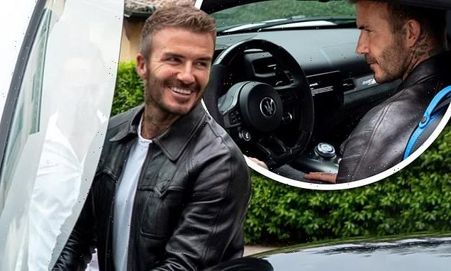 David Beckham looks suave behind the wheel of a £187k Maserati