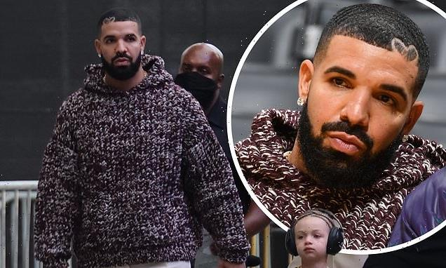 Drake arrives with his son Adonis to the Lakers basketball game in LA