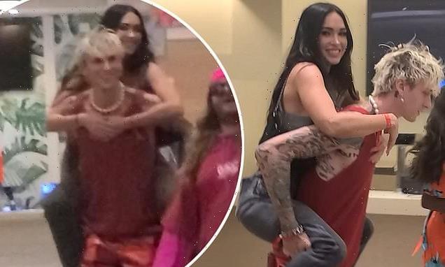 Machine Gun Kelly gives Megan Fox a piggyback at boxing match in Miami