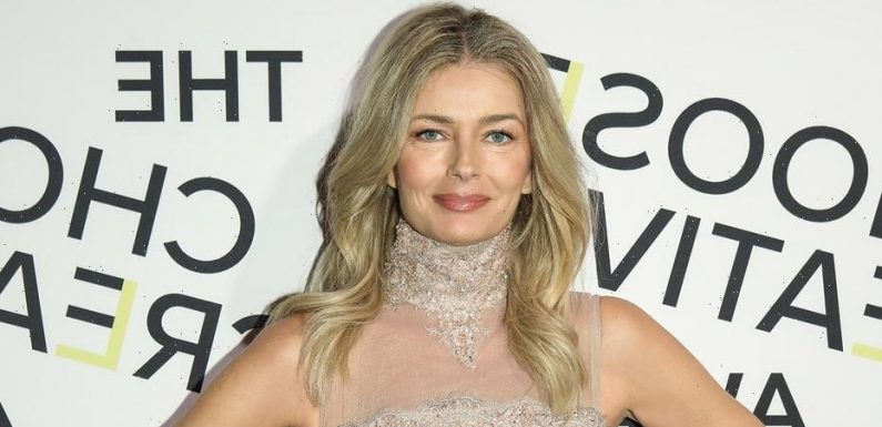 Paulina Porizkova pulls out iconic gold string bikini for vacation 'with someone special'
