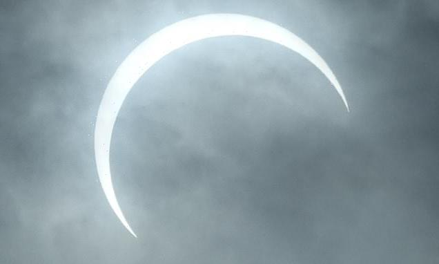 Rare partial solar eclipse will appear over the UK and US TODAY