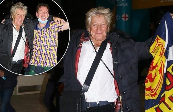 Rod Stewart puts on an animated display as he leaves Wembley