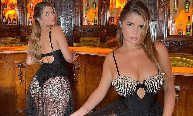 Demi Rose showcases her curves in black leotard and matching skirt