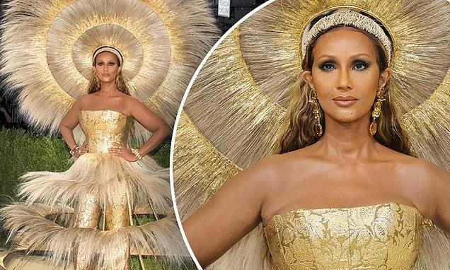 Iman rocks a giant gold headdress on the red carpet of the Met Gala