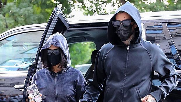 Kourtney Kardashian & Travis Barker Twin In Black Hoodies & Pants As They Arrive In NYC With Kim
