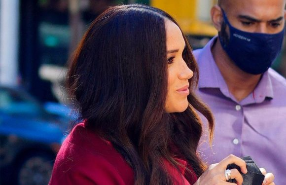 Meghan Markle stuns in scarlet outfit during school visit with Prince Harry