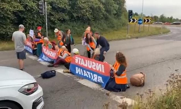 Motorists clash with Insulate Britain climate activists blocking M25
