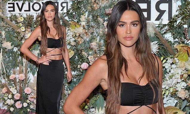 Newly-single Amelia Hamlin flaunts her toned abs in cut-out dress