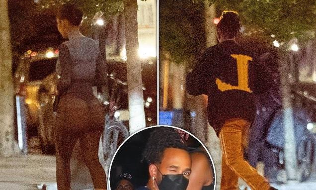 PICTURE EXC: Lewis Hamilton returns to his hotel with a mystery woman